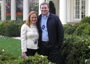 Gregory Mecher and his wife Jen Psaki